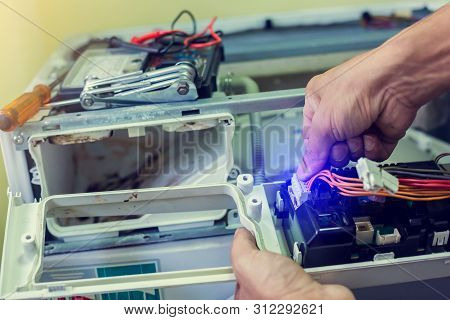 Washing Machine Repair. Hands Of Technician Connect Cable To Electronic Board.repairer Man. Man Fixi