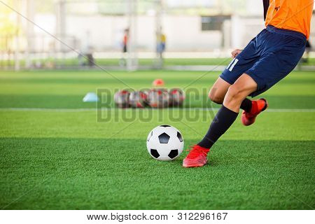 Soccer Player Speed Run To Shoot Ball To Goal On Artificial Turf. Soccer Player Training Or Football