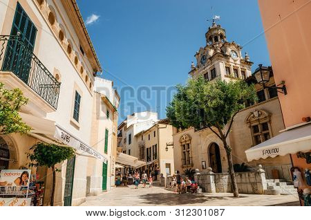 Alcudia, Mallorca, Spain - May 23, 2015: Architecture Of Majorca. The Tower With Big Clock Of City T