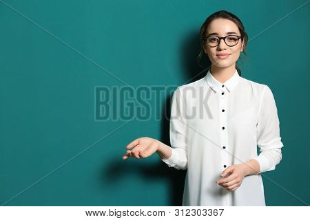 Portrait Of Beautiful Young Teacher Near Chalkboard, Space For Text