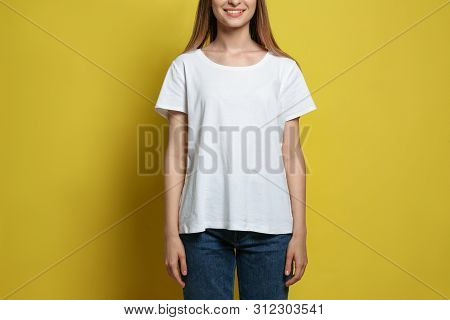 Young Woman Wearing Blank T-shirt On Yellow Background, Closeup. Mockup For Design