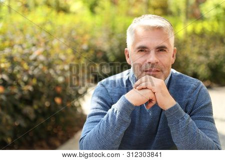 Handsome Mature Man In Park. Space For Text