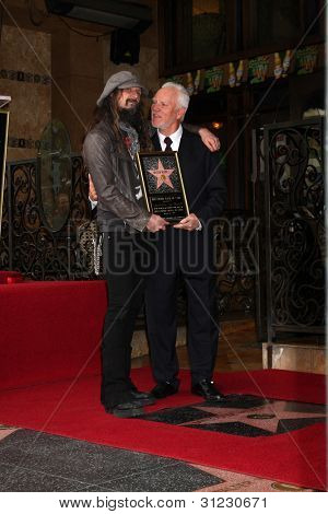 LOS ANGELES - MAR 16:  Rob Zombie, Malcolm McDowell at the Malcolm McDowell Walk of Fame Star Ceremony for The Muppets at the Hollywood Boulevard on March 16, 2012 in Los Angeles, CA