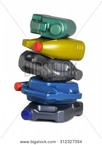 Stack of Empty Engine Oil Containers on White Background
