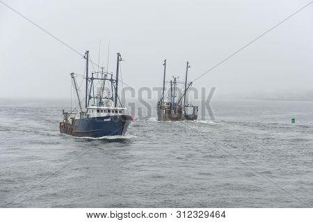New Bedford, Massachusetts, Usa - July 12, 2019: Commercial Fishing Vessels Avenger And Settler Pass