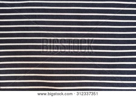 Black With White Stripes Seamless Fabric. Textural Background