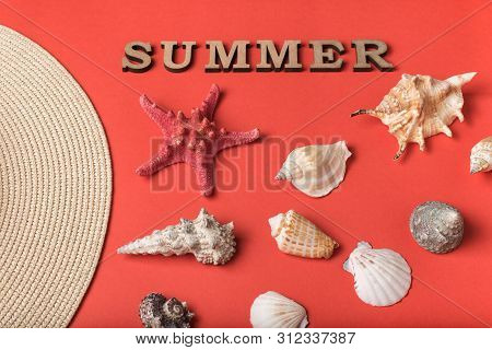 Word Summer From Wooden Letters. Seashells, Part Of A Hat And A Live Coral Background. Flat Lay. Mar