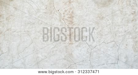 Old Gray Wall With Cracks On The Plaster. Abstract Background.