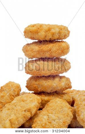 a pile of chicken nuggets on a white background