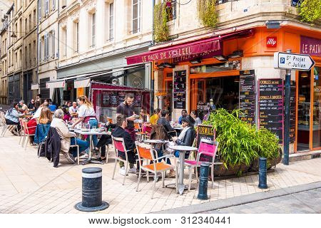 Bordeaux, France - May 5, 2019: Typical Bordeaux City Scene. Residents Of The City And Tourists Rela