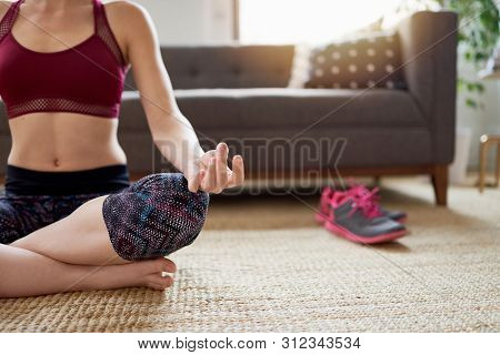 Trendy Woman Doing Yoga As Part Of Her Mindfulness Morning Routine