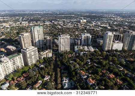 Aerial view of apartments, condos and houses along Wilshire Blvd near Century City in Los Angeles, California.