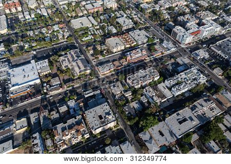 Aerial of apartments and commercial buildings along La Brea Ave in the Hollywood neighborhood of Los Angeles, California.