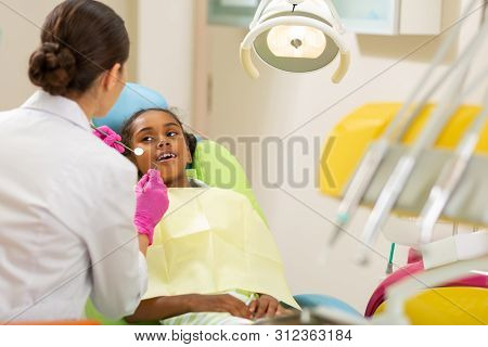 Female Dentist In Aseptic Gloves Holding Dentists Tools