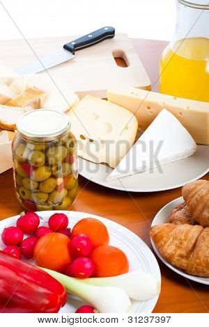 Table With Cheese, Olives, Vegetable And Knife
