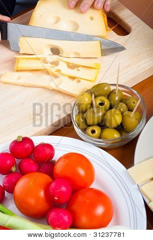 Preparing Olives And Emmenthal Cheese