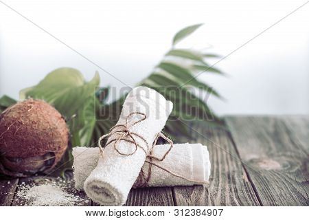 Spa And Wellness Setting With Flowers And Towels. Dayspa Nature Products With Coconut
