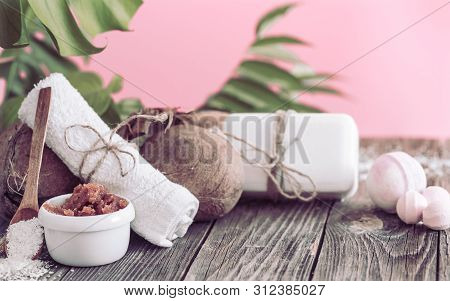 Spa And Wellness Setting With Flowers And Towels. Bright Composition On Pink Background With Tropica