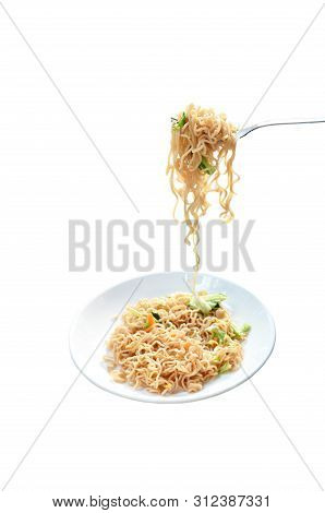 Fried Instant Noodles With Cabbage And Egg Stabbing In Silver Fork Isolated On Plate