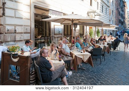 Rome, Italy - September 20, 2013: People Sitting At Outdoor Tables In The Restaurant . Al Fresco Din