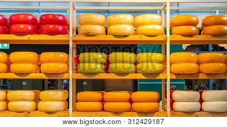 Dutch Cheeses, Edam, Gouda, Whole Round Wheels On Wooden Shelf, Cheese Store In Rotterdam, Netherlan