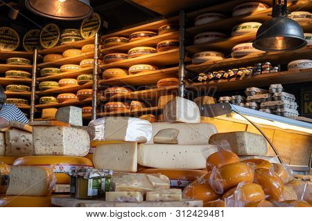 Dutch Cheeses, Edam, Gouda, Whole Round Wheels In A Cheese Store In Rotterdam, Netherlands