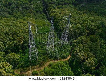 Aerial View. High Voltage Metal Post. High-voltage Towers In The Forest