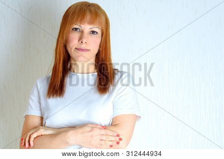 Attractive Middle Aged Woman Relaxing At Home.a Woman In The Period Of Menopause. Blond Or Red Hair