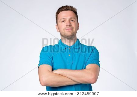 Smart Self Confident Young European Man In Blue T-shirt