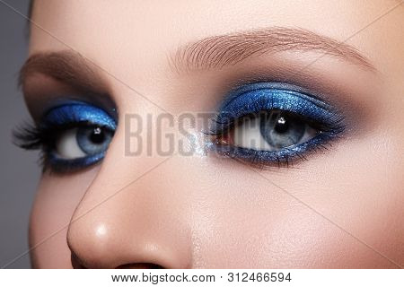 Closeup Macro Of Woman Fashion Make-up Of Eyes. Glitter Blue Celebrate Makeup, Perfect Color Of Eyes