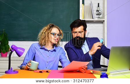 Young Male Teacher With Female Student. College Students At Campus. Teachers Couple In Classroom. Tu