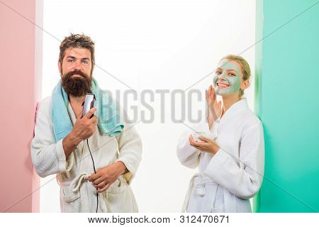 Couple. Relationship. Bearded Man With Electric Shaver. Cosmetic Facial Mask. Morning Treatments. Mo