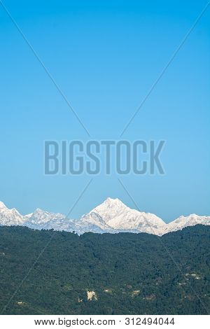 Mountains Peaks With Blue Sky Background In North Sikkim, India