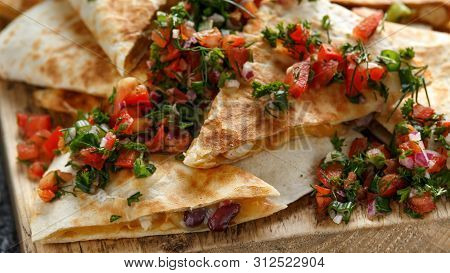 Mexican Food Quesadillas With Chicken And Cheese Served On Rustic Wooden Chopping Board With Homemad