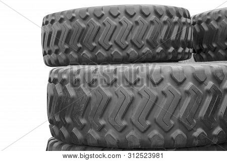 Large Rubber Tires For Trucks Lying On The Street. Black Tires Close Up With A Large Tread Lie On To