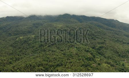 Mountains With Rainforest, Trees In Cloudy Weather, Aerial Drone. Camiguin, Philippines. Mountain La