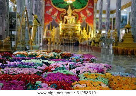 colorful flower candle for making worship merit to buddha poster