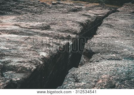 cracked rock canyon. crack rift crevice in stone poster