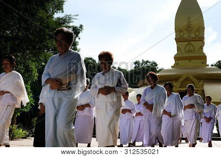 Buddhist People Walking For Meditation In Temple