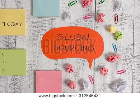 Word writing text Global Sourcing. Business concept for practice of sourcing from the global market for goods Blank speech bubble paper balls clips sticky notes old wooden background. poster