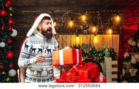 Christmas Man In Santa Hat. Santa Claus Wishes Merry Christmas. New Year Gift. Santa Claus Gifting G