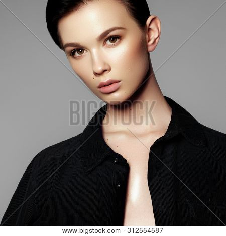 Fashion Model Portrait. Beautiful Young Woman On Grey Background. Model With Natural Makeup. Fashion