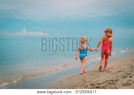 Cute Little Girls Go Swim On Beach Vacation