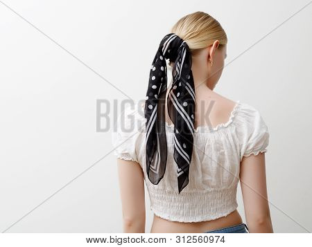 Minimalist Photo, Fashionable Girl In Stylish Summer Things . View From The Back. Earrings, A Ring ,