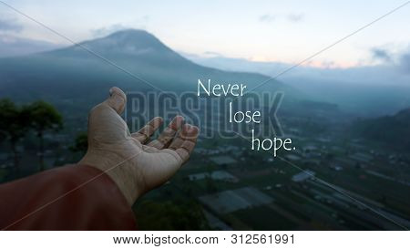 Inspirational Motivational Quote - Never Lose Hope. With A Human Hand Open, Full Of Positive Negativ