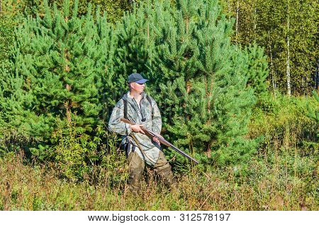 Hunting In Autumn Forest