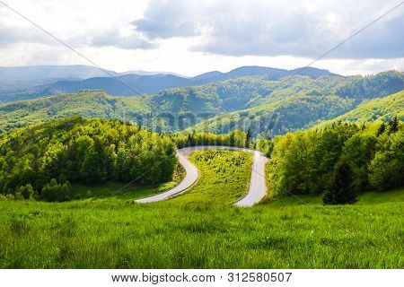 Mountain Winding Road In Slovakia, View From Above With A View Of The Mountains.
