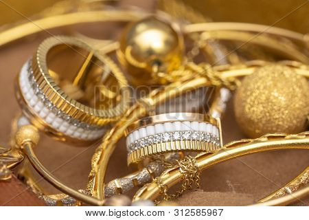 Closeup To Colored Gold Jewelry Accessories Fashion