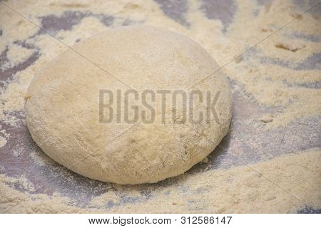 Dough And Flour On A Wooden Board Close-up