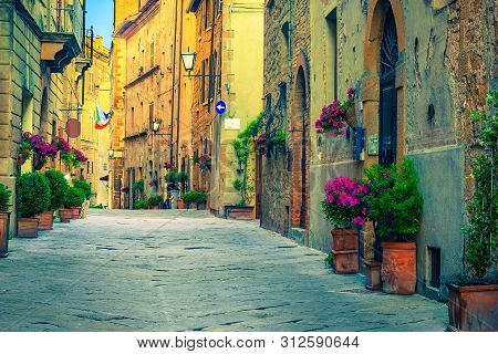 Picturesque Traditional Tuscany Street View. Beautiful Medieval Stone Houses And Paved Street With F